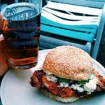 Eat a Spicy chicken sandwiches at The Commodore